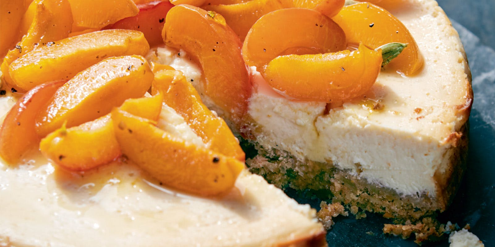 Labneh cheesecake with roasted apricots, honey and cardamom